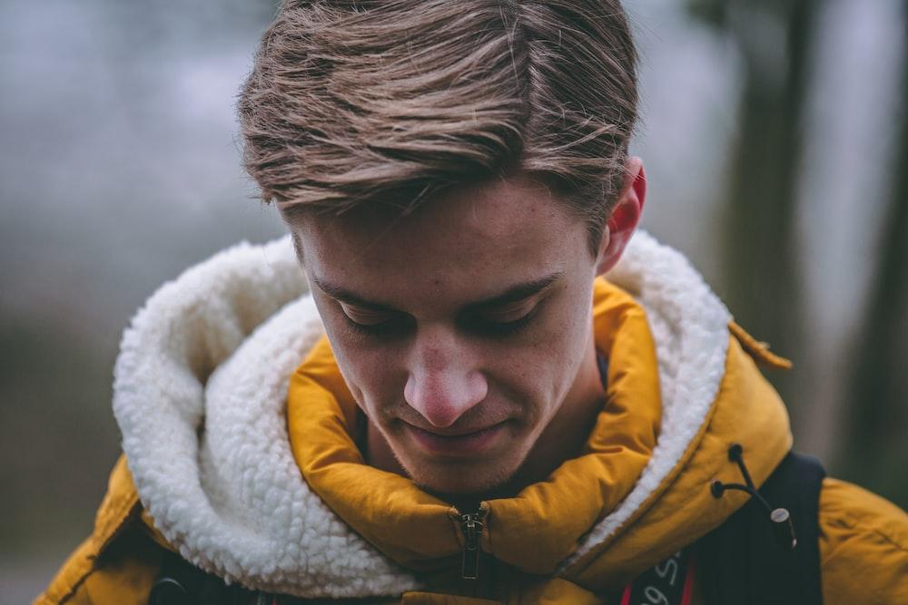 man wearing hoodie smiling