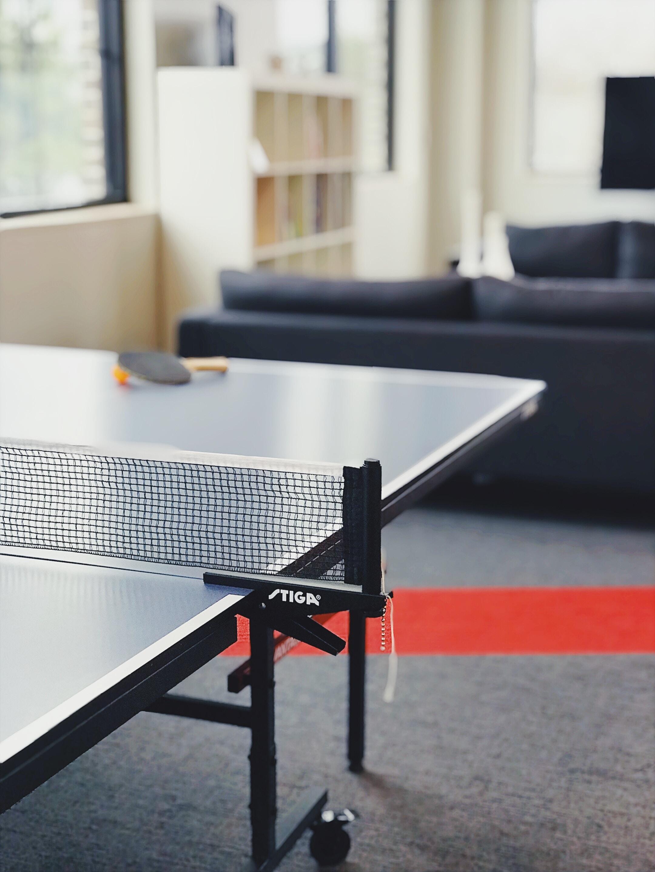 racket and ball on tennis table