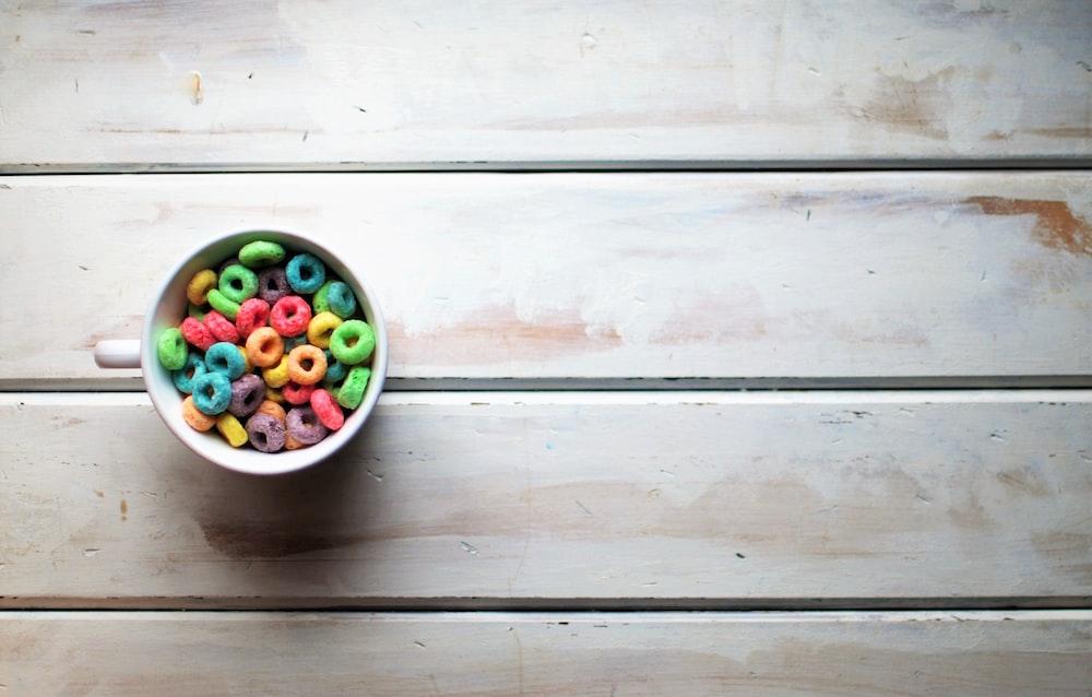white ceramic mug with assorted-color beads