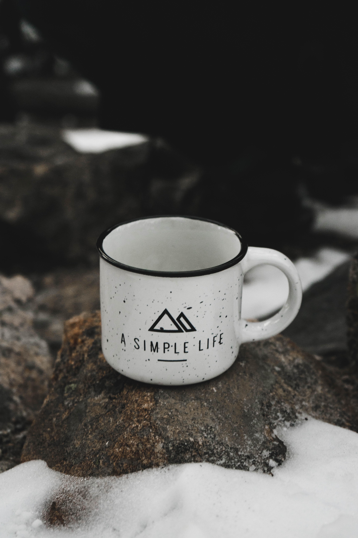white ceramic mug on rack