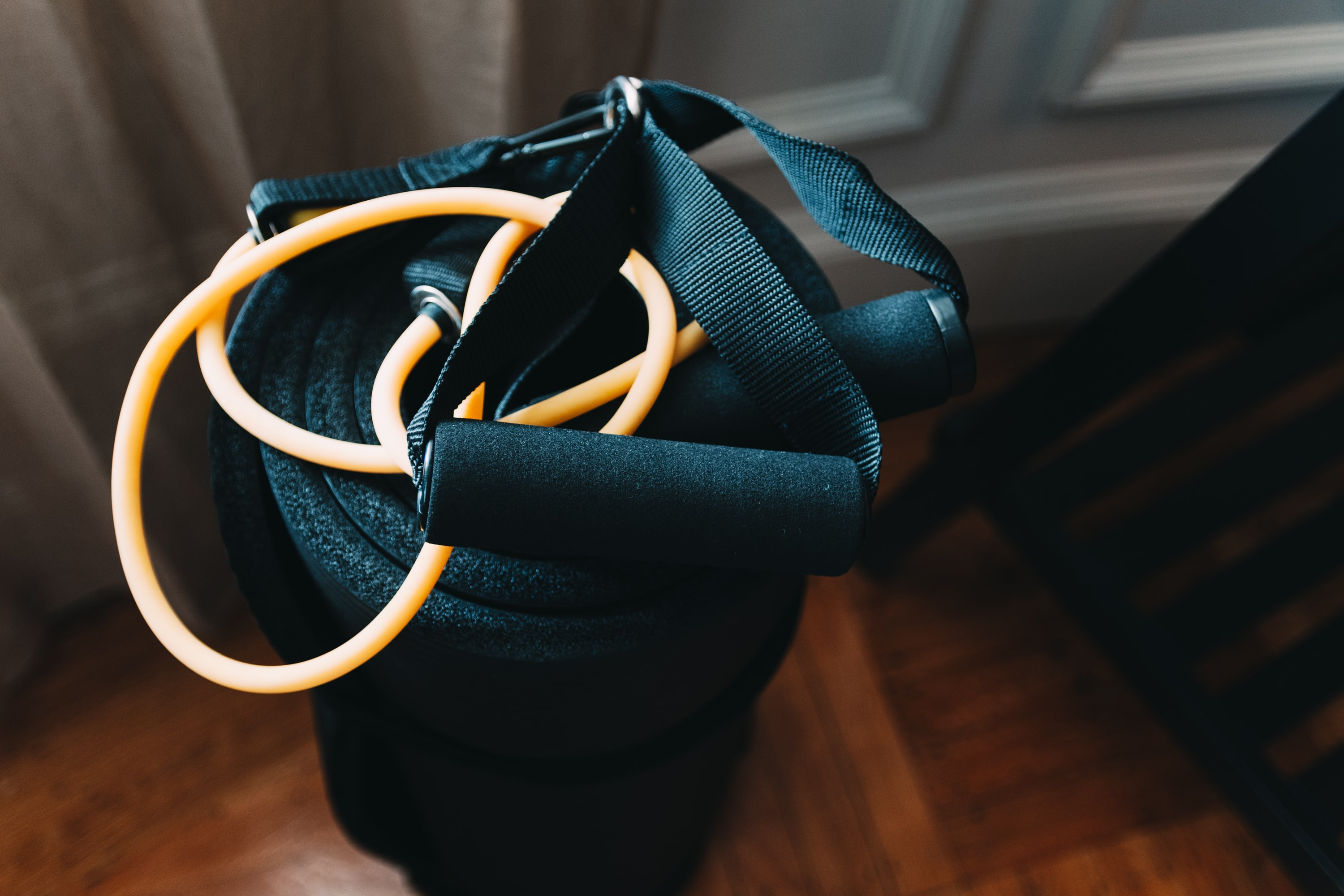 shallow focus photography of yellow and black stretch rope