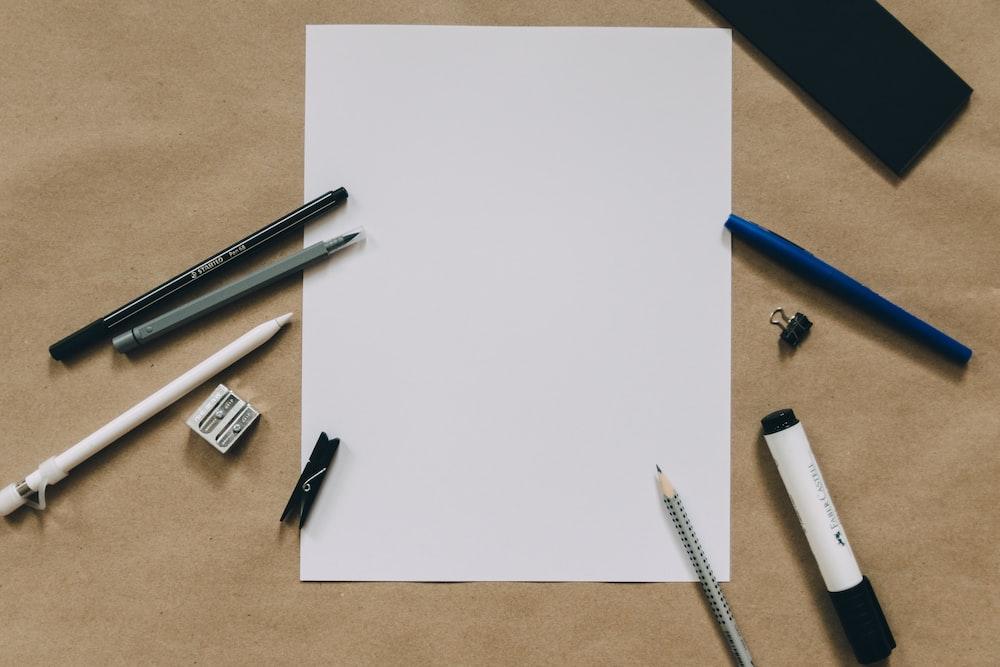 pens near white paper