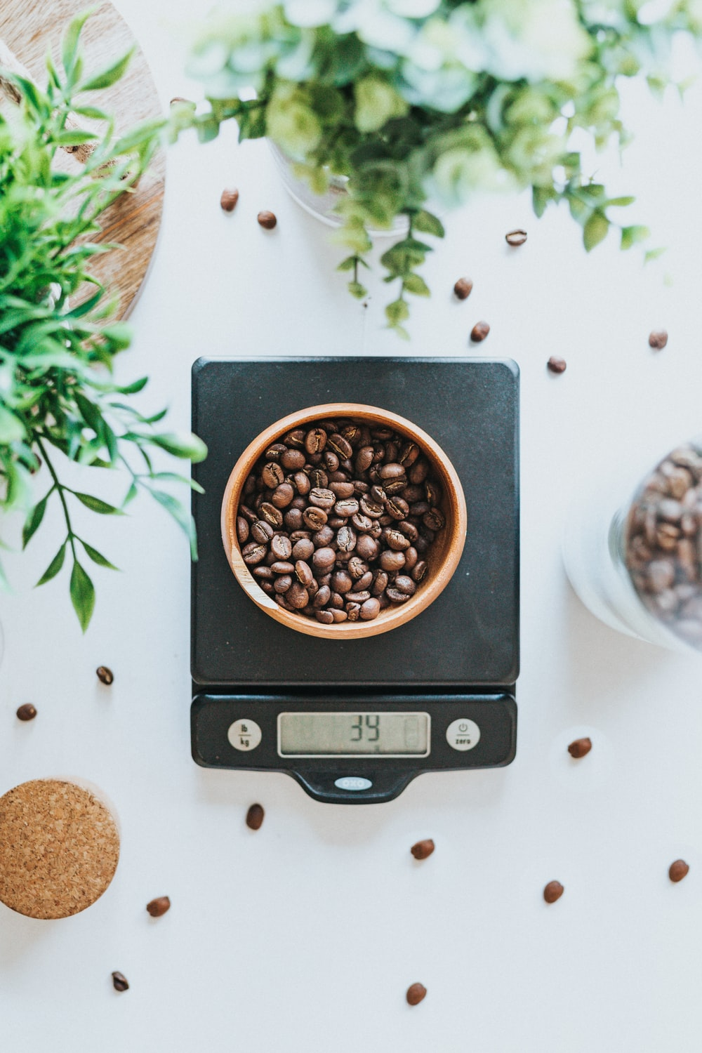 photo of bowl filled with coffee beans on black digital scale at 39 grams