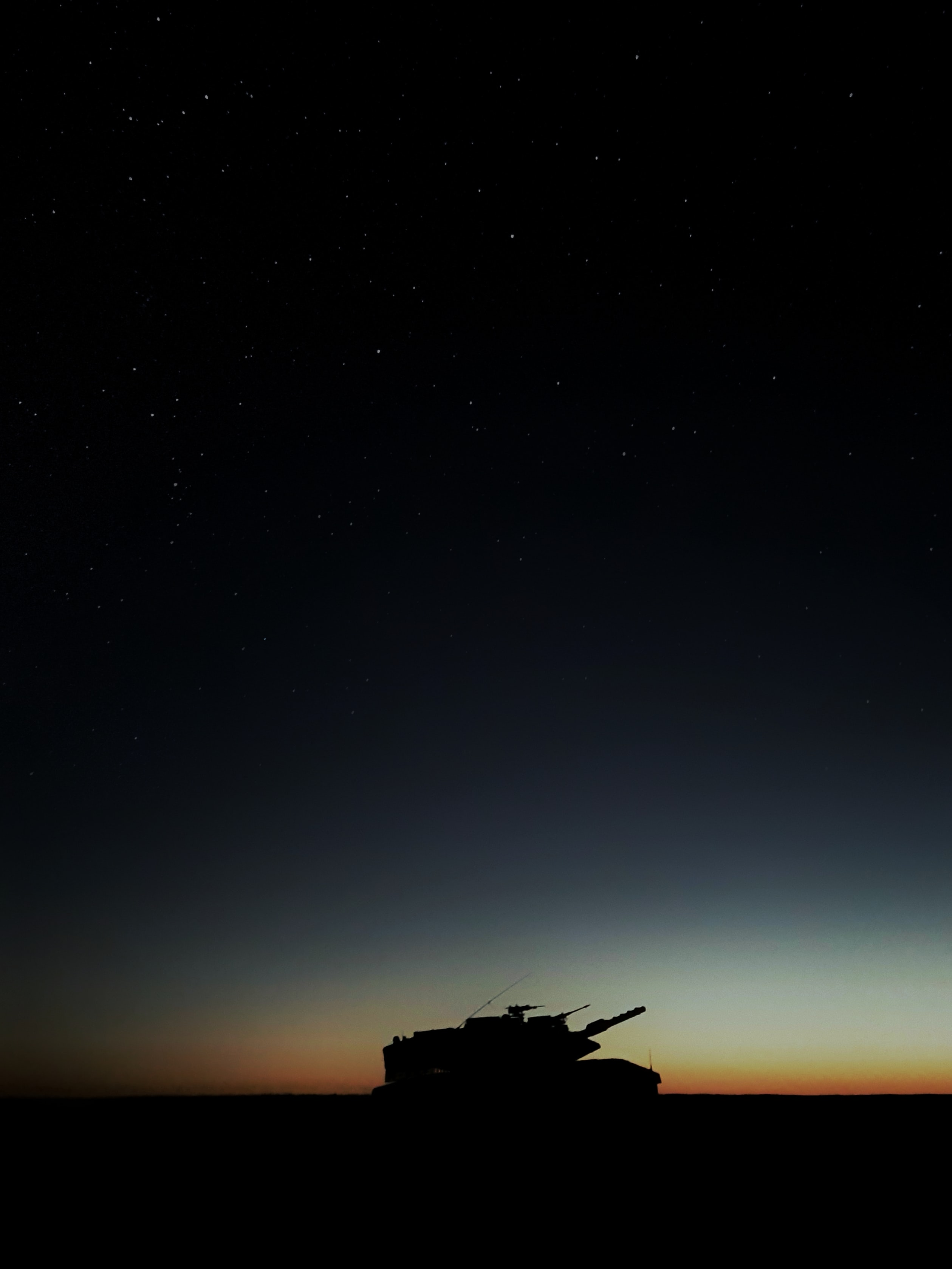 silhouette photo of battle tank