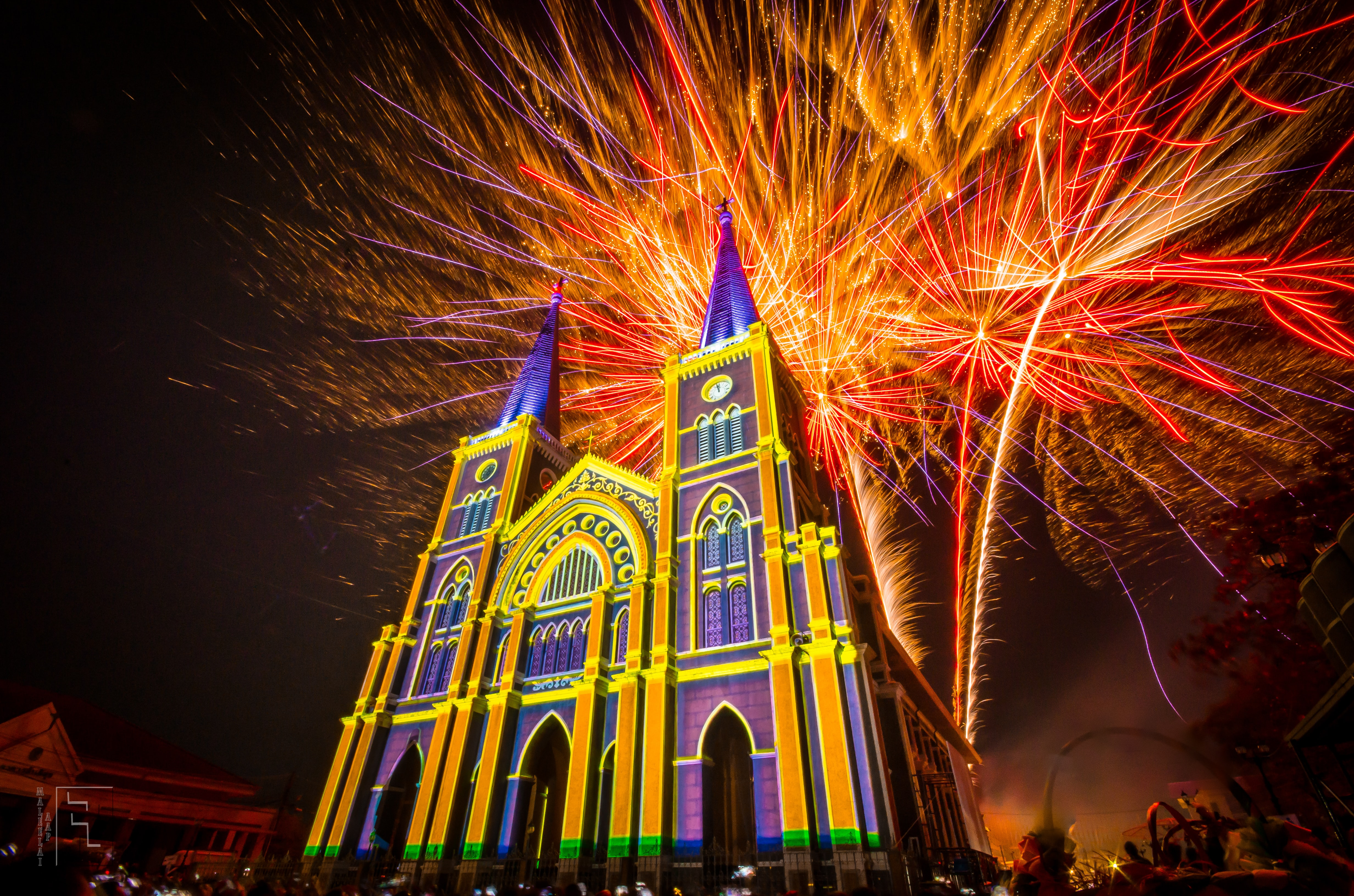 church and fireworks display during night time