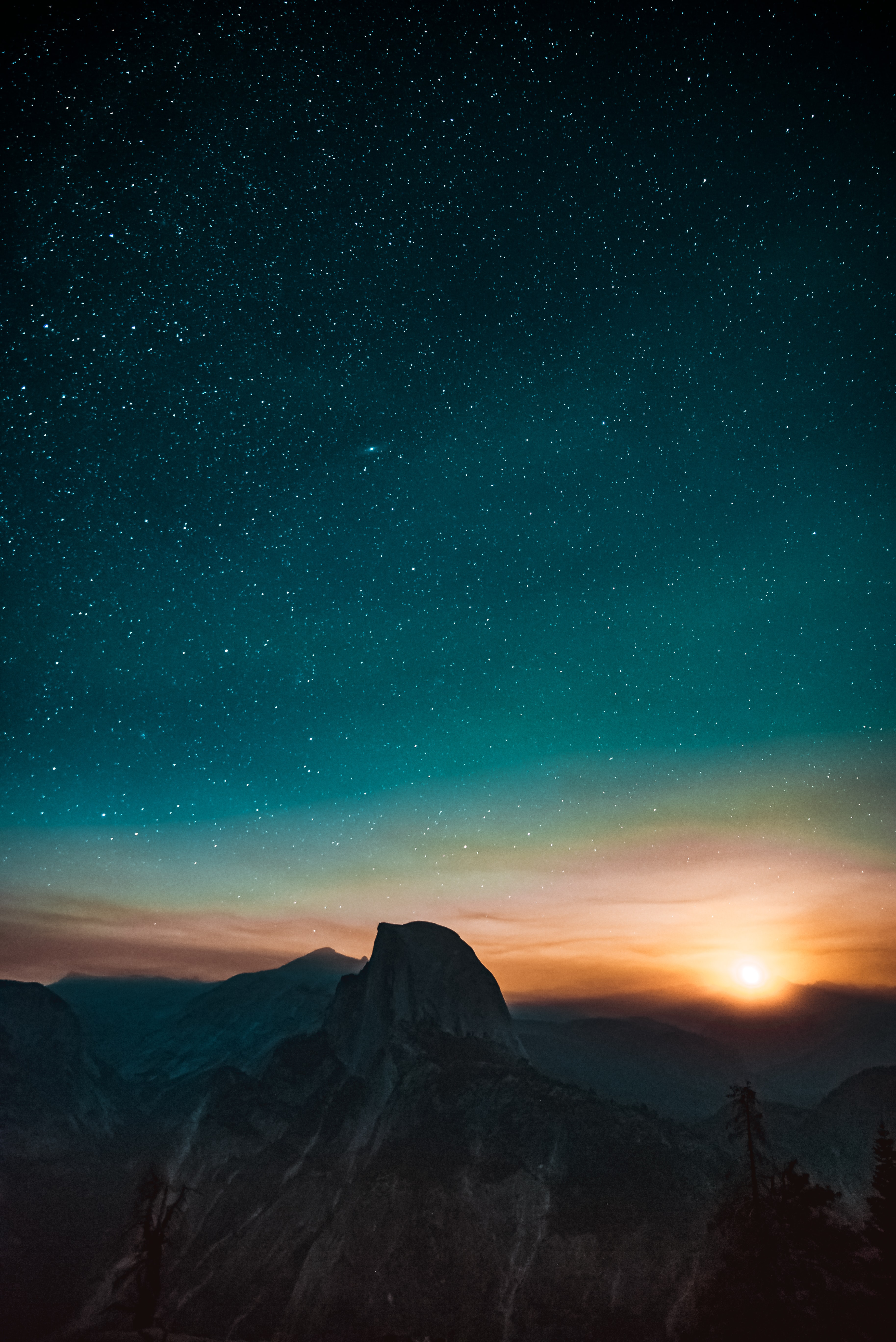 high-angle photography of mountain at sunset