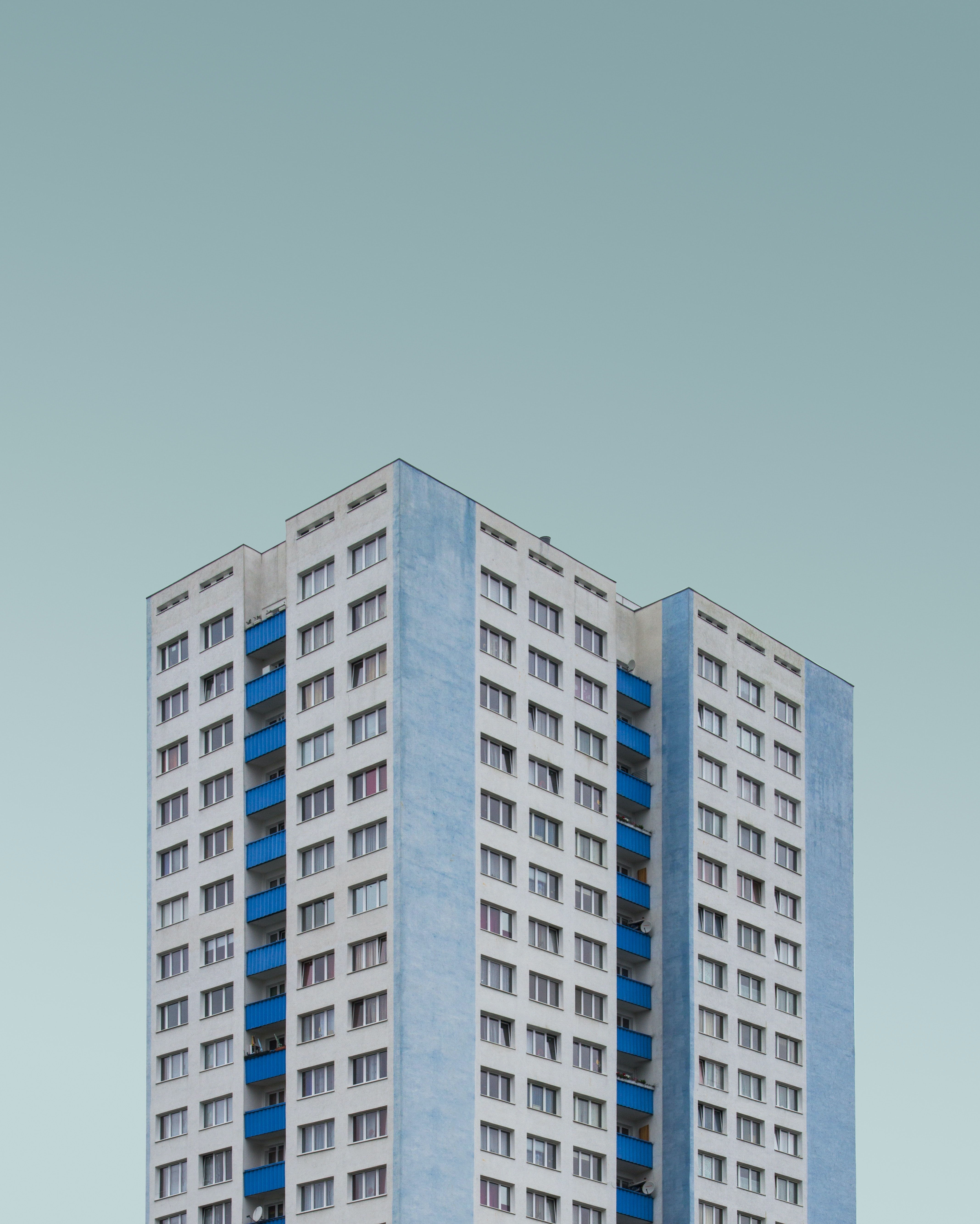 white and blue concrete high rise building