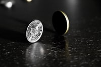 photo of rolling silver-colored coin