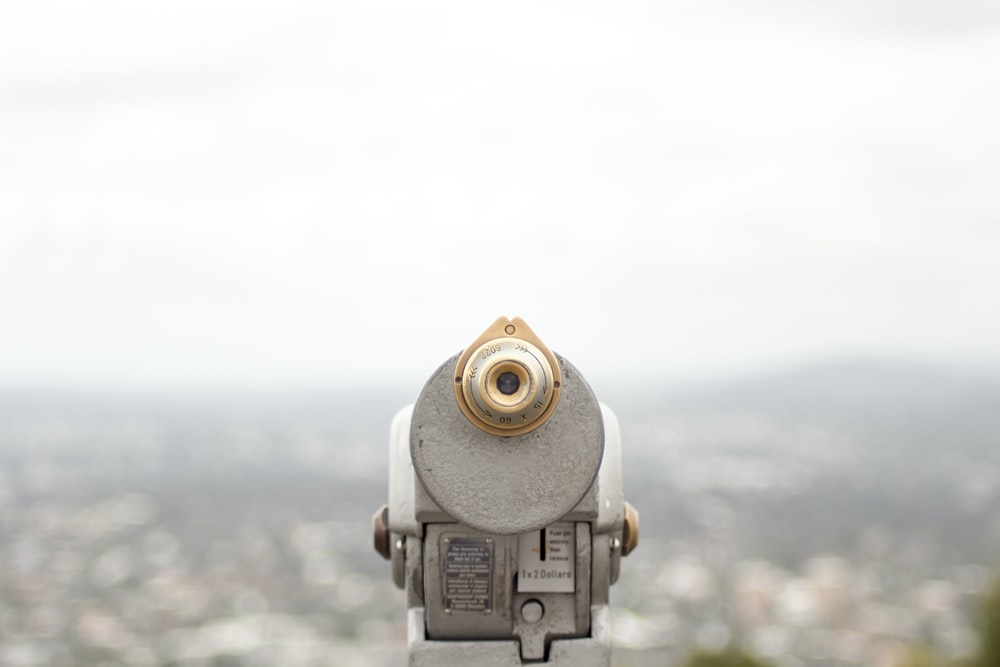closeup photography of coin operated telescope