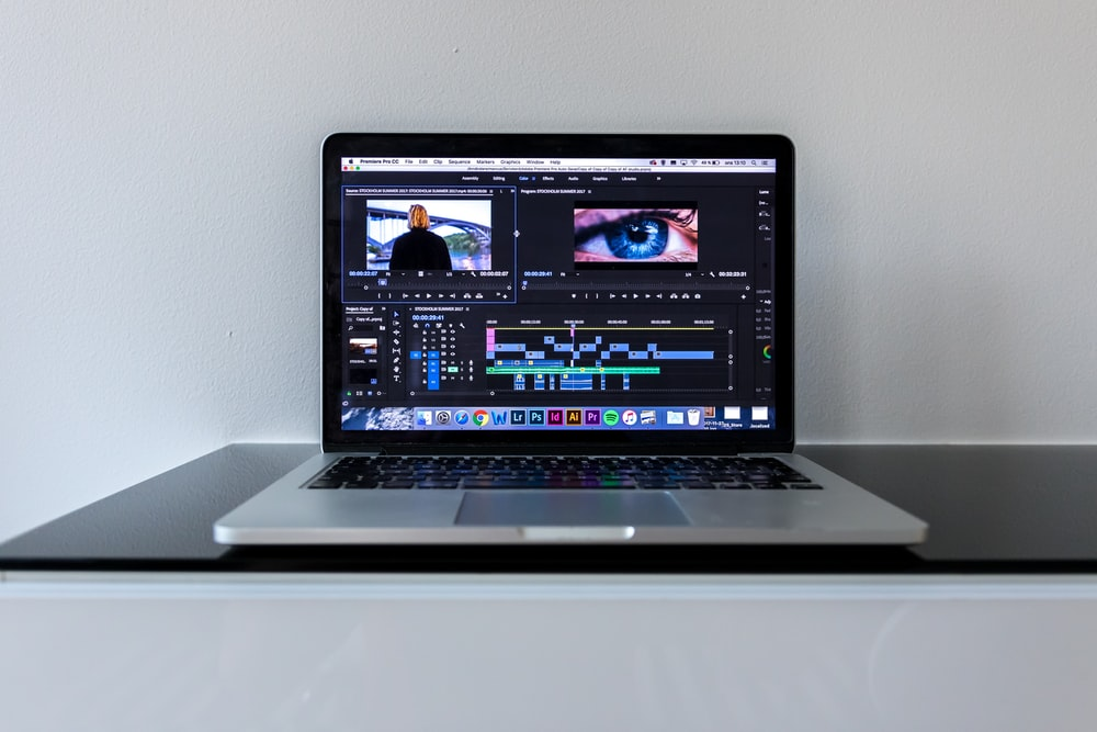 MacBook Pro on black desk