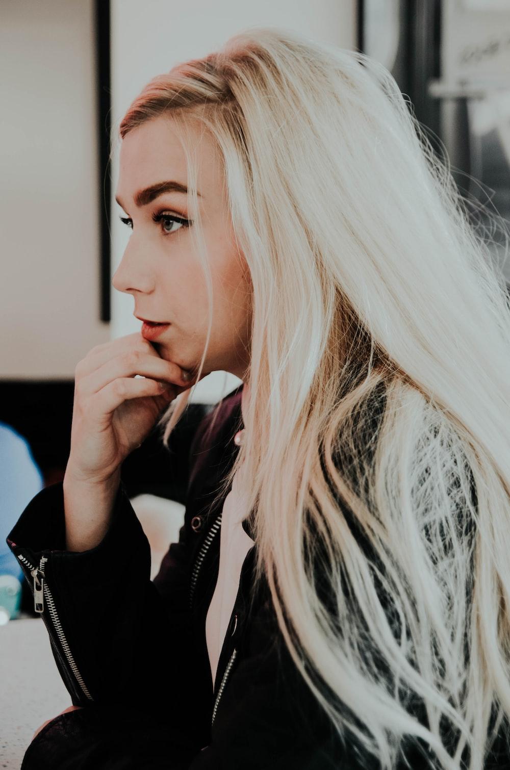 beige hair woman wearing black jacket