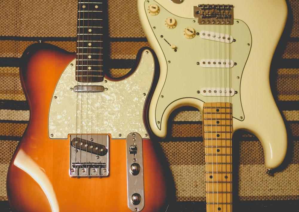 orange and white electric guitars
