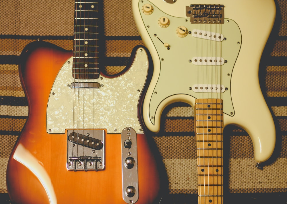 orange and white electric guitars
