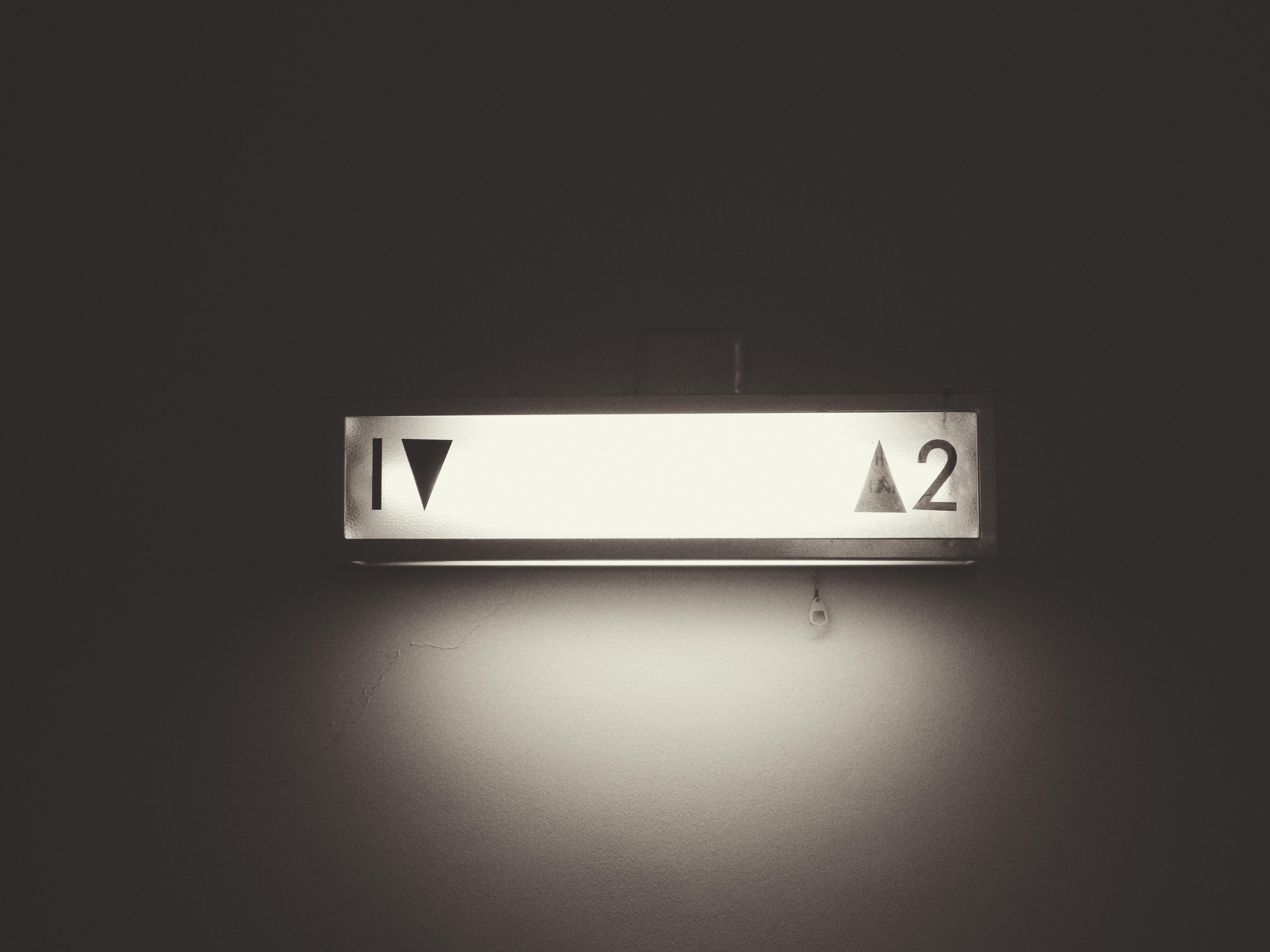 gray framed 1 and 2 elevator signage