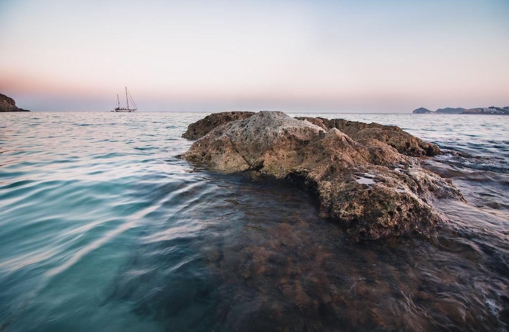 brown rocks on shore