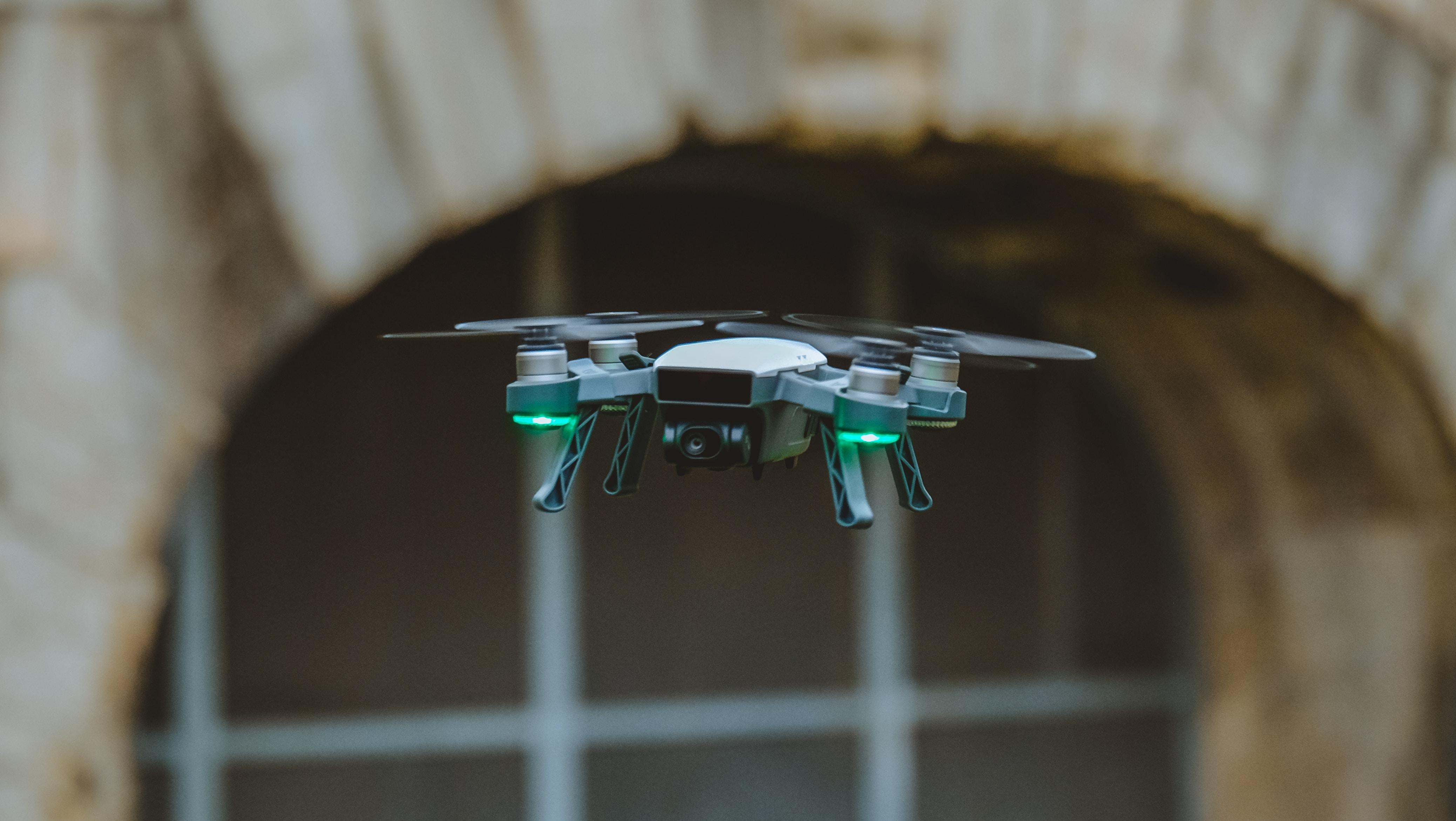 selective focus photo of black quadcopter