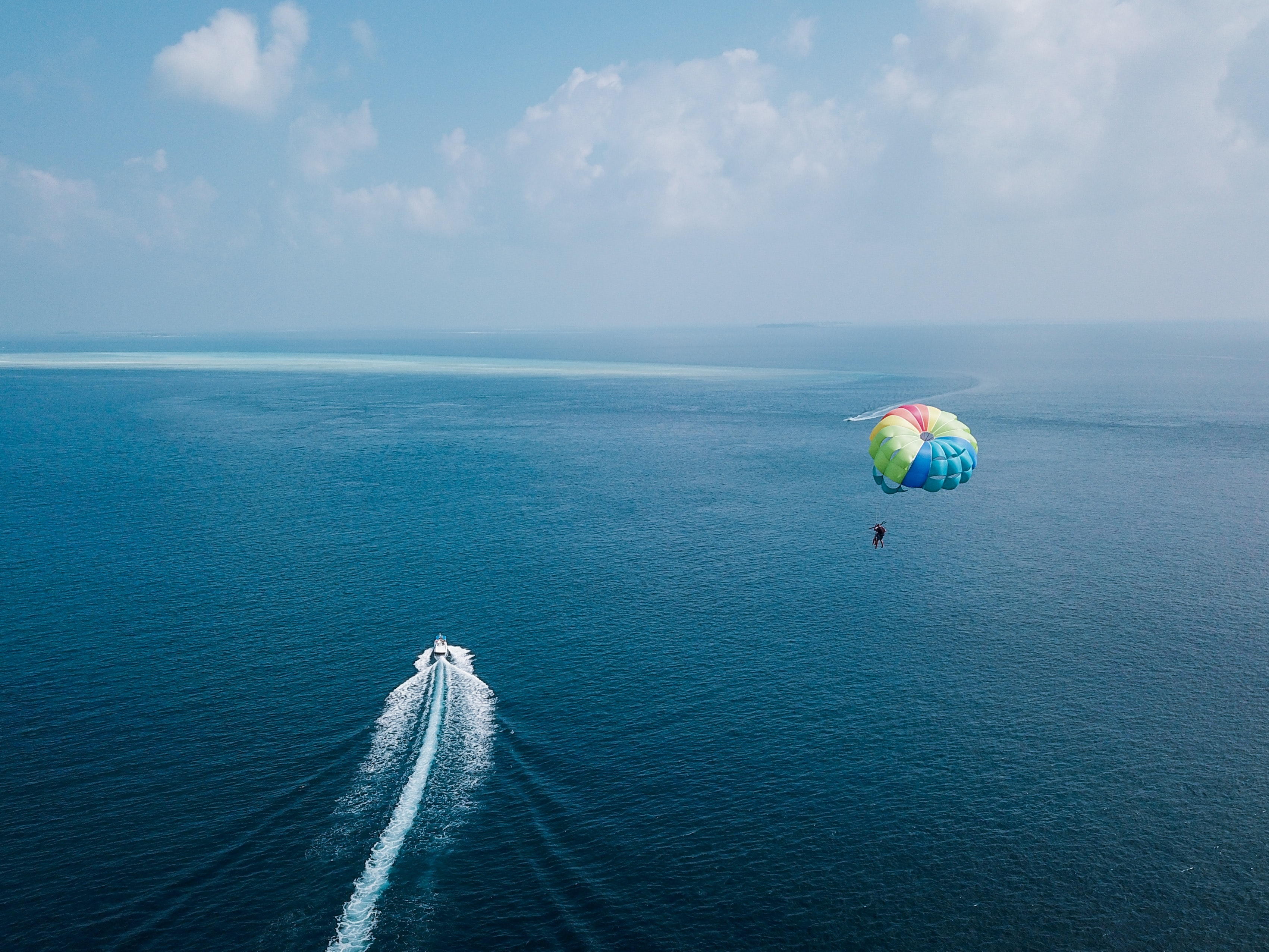aerial photography of paragliding
