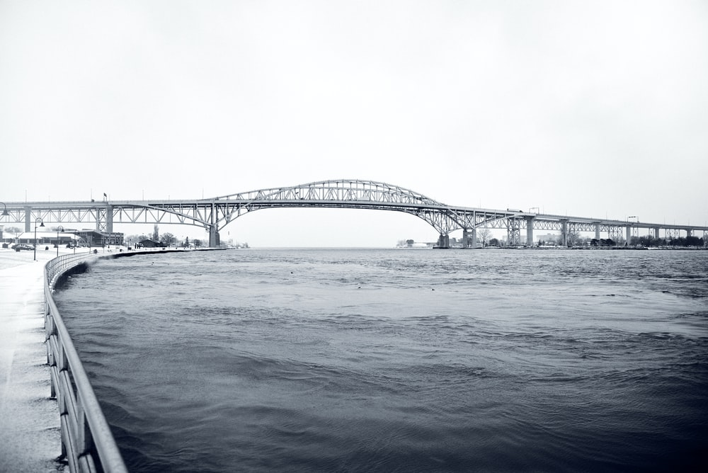 grayscale photo of bridge over water