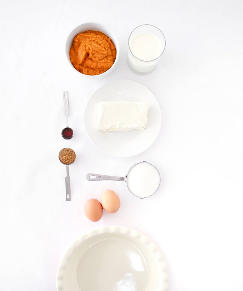 assorted ingredients on white table