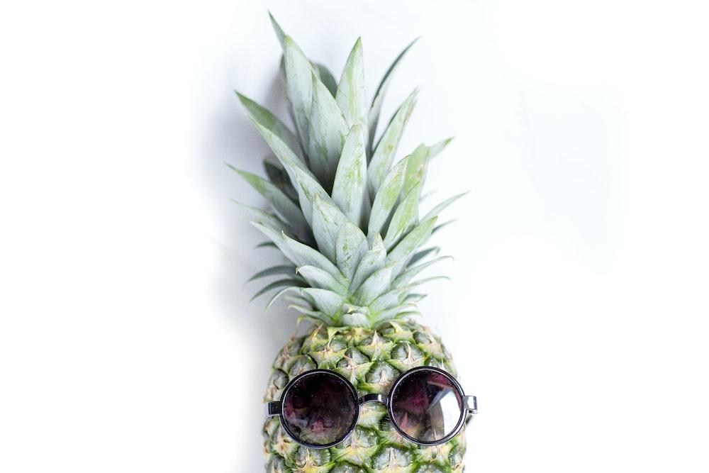 focus photo of green pineapple