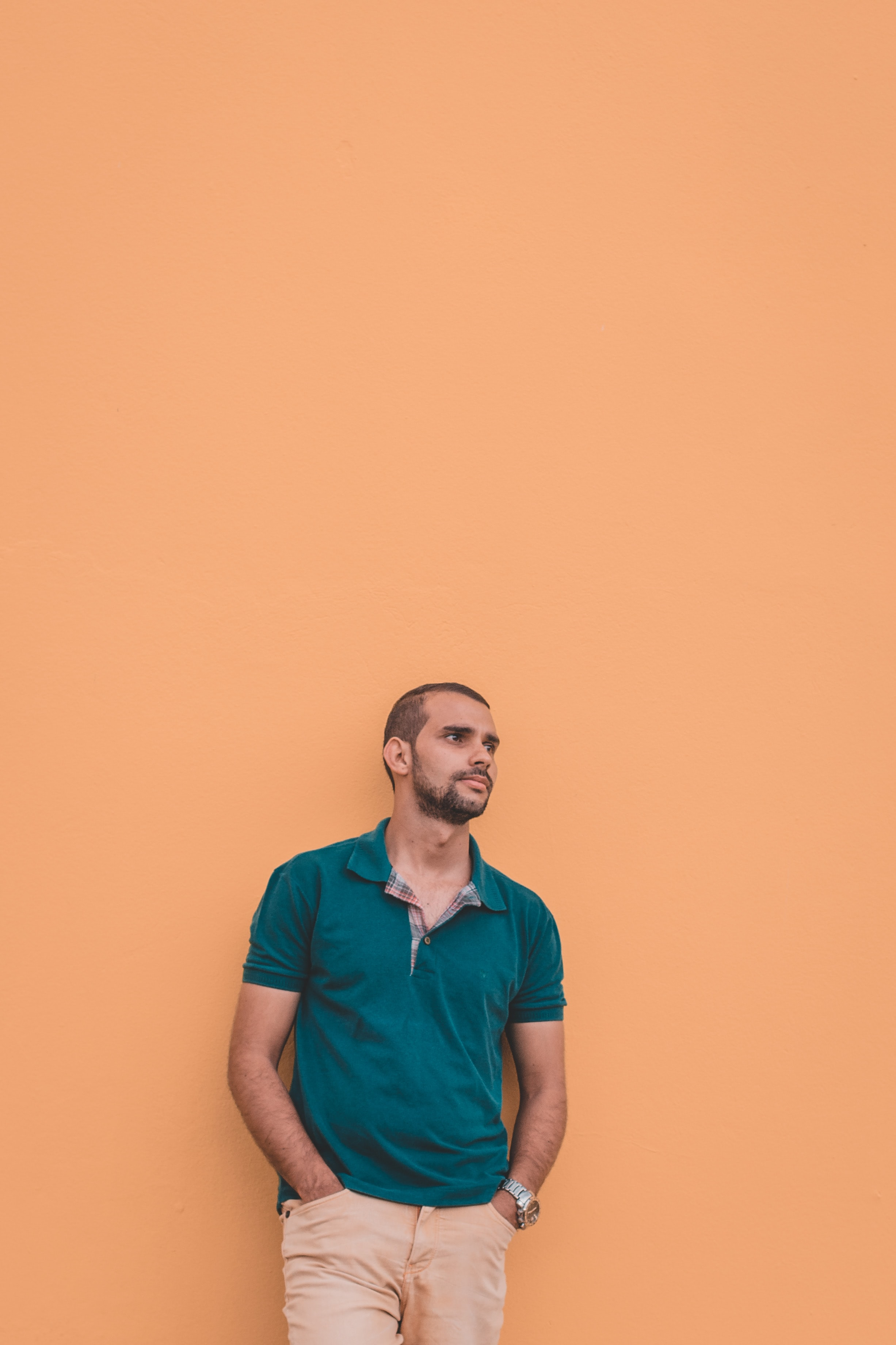 man in teal polo shirt