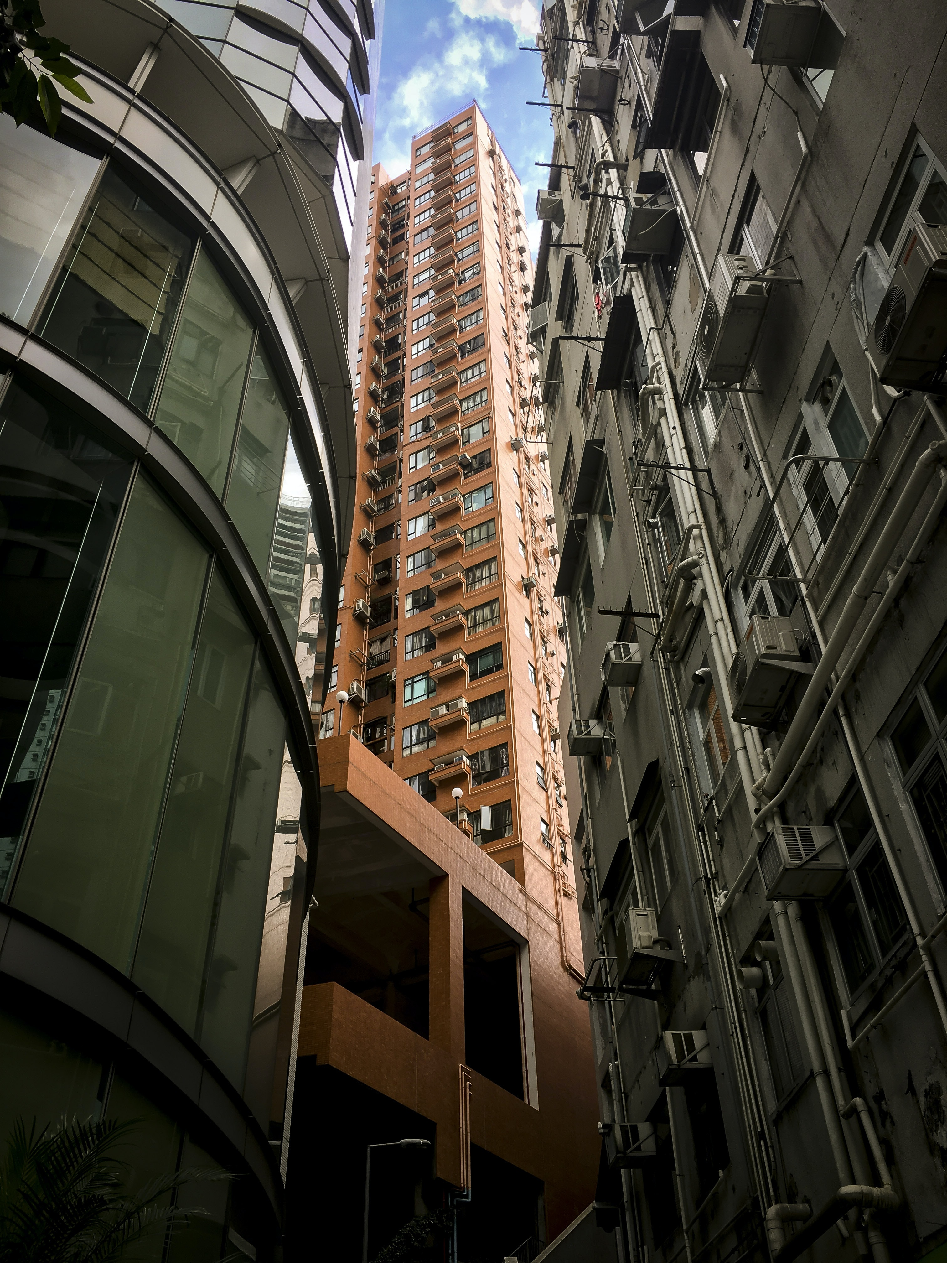 brown high-rise concrete building during daytime