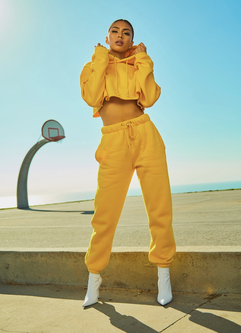 woman in yellow tracksuit standing on basketball court side