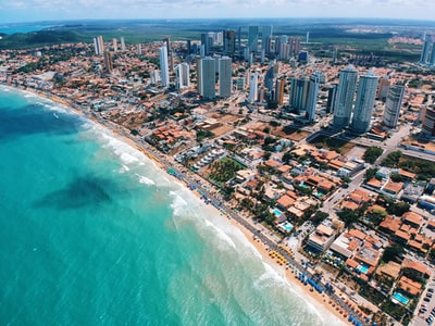 aerial photography of city building near the seashore during daytime brazil teams background