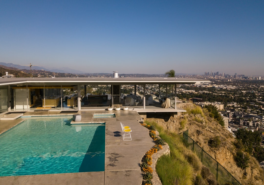 One of the most recognizable homes in Los Angeles, the Stahl House was etched into our memory from the renowned architectural photographer, Julius Shulman.  Here is a different view showing the relation of the house to downtown.