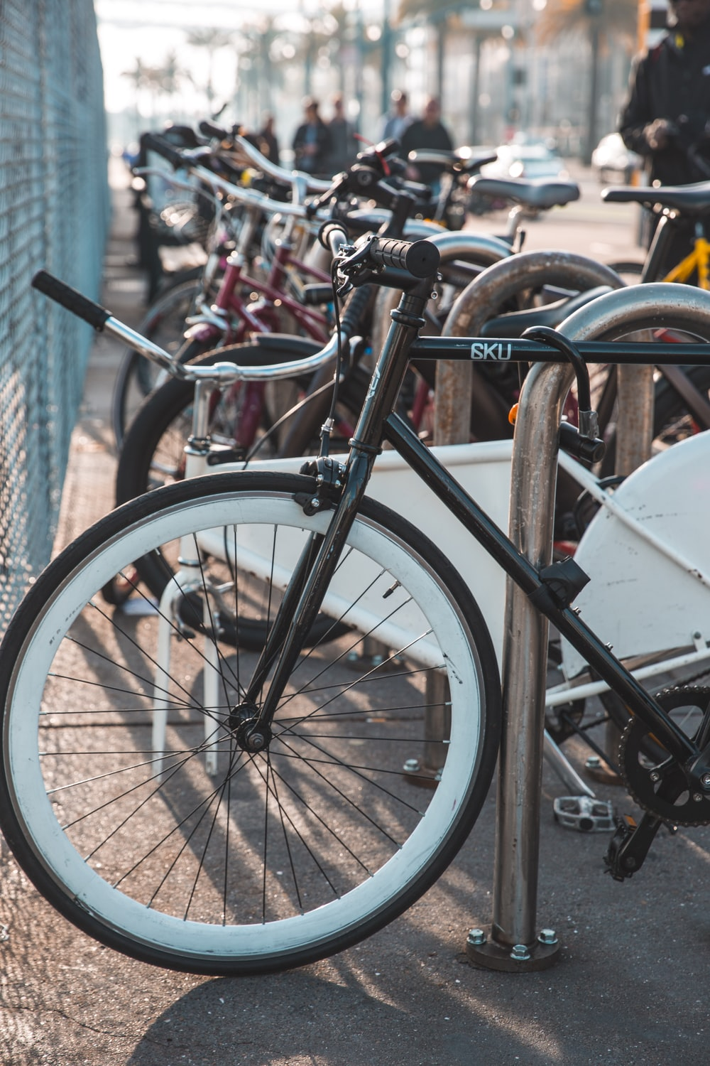 bicycles parked near grey metal fence