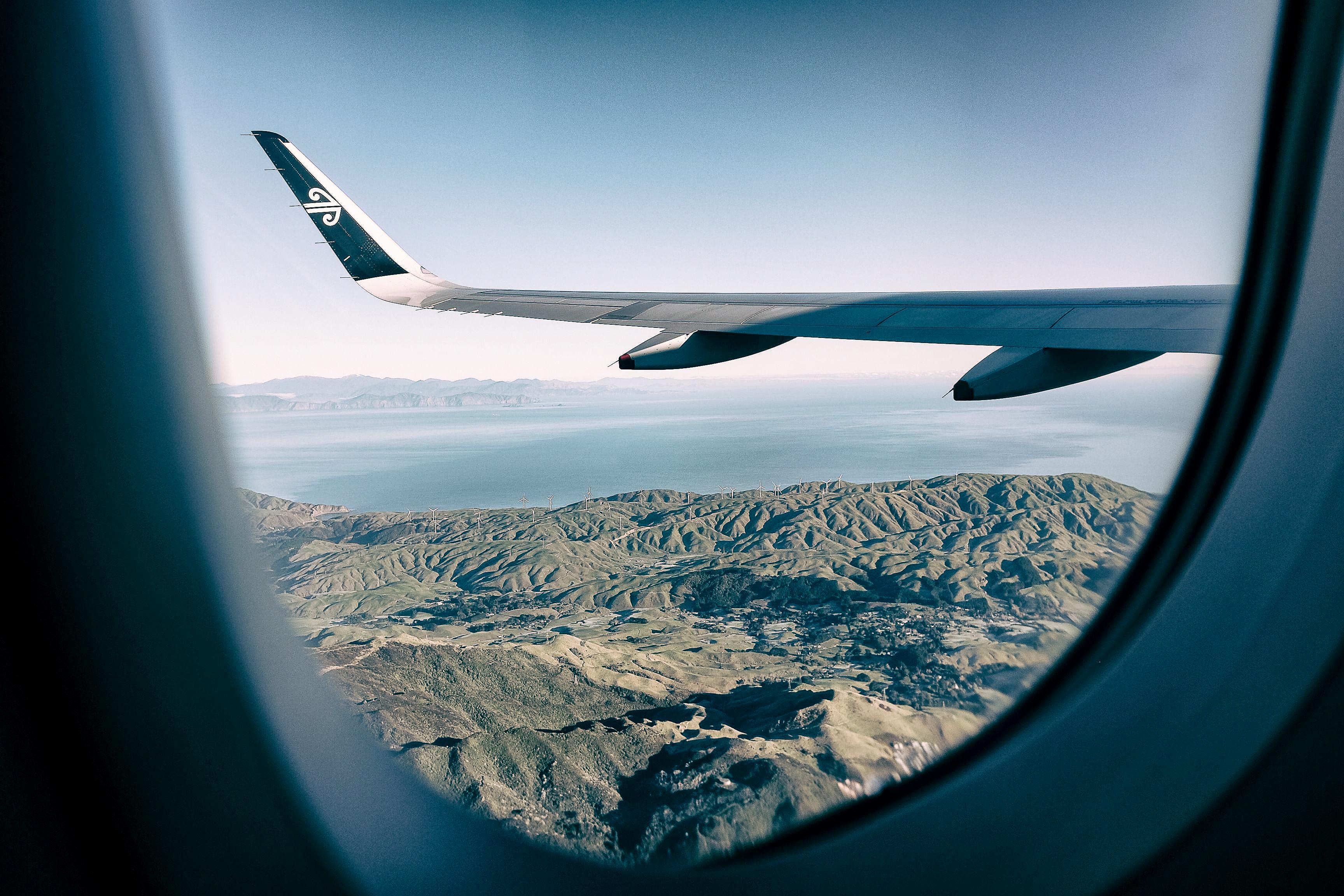 plane wings outside plane window