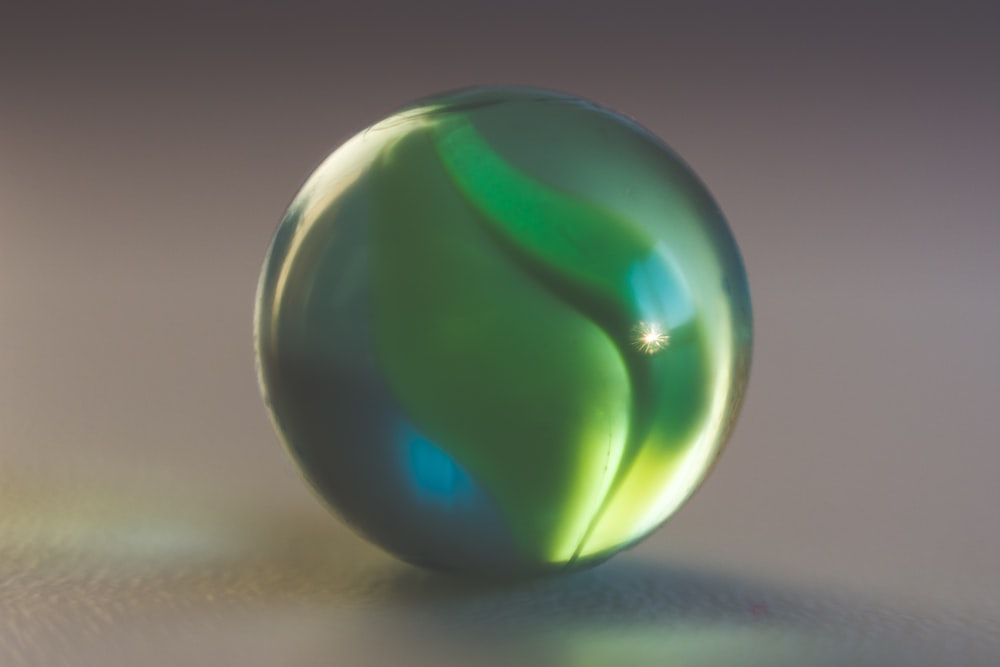 selective-focus photography of green marble