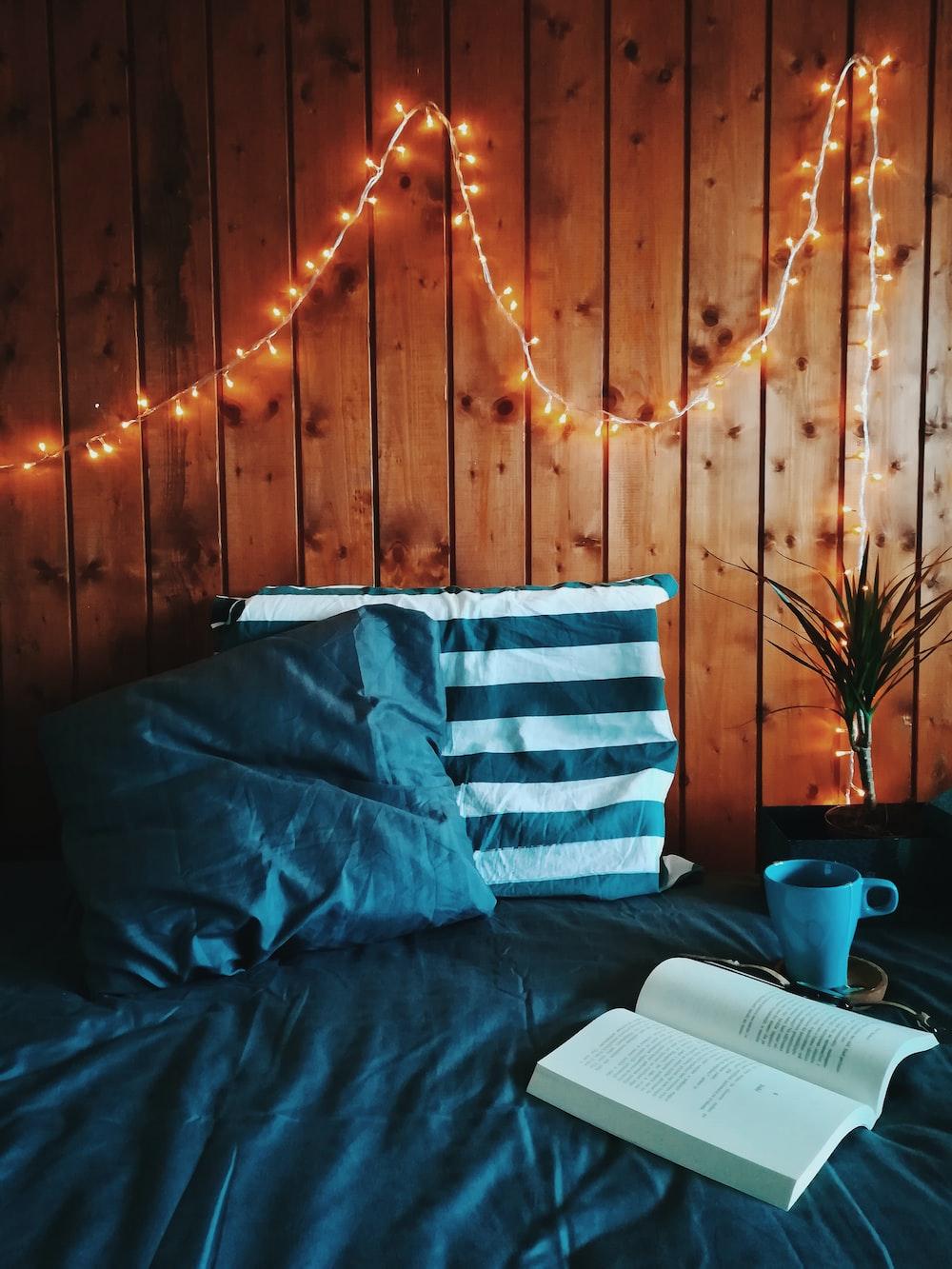 open book beside of blue mug