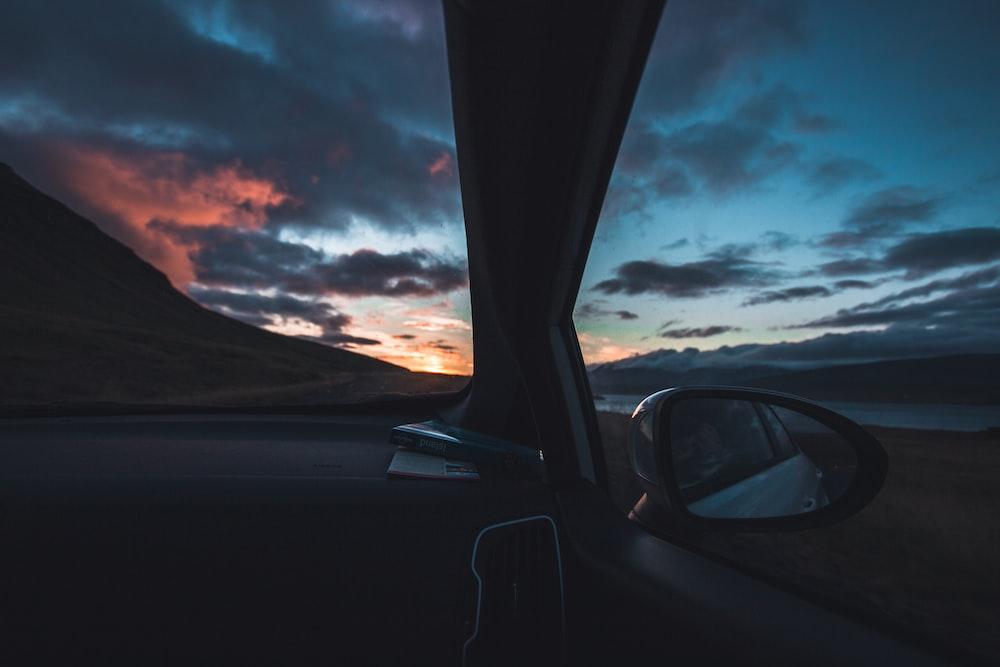 closeup photo of car wing mirror