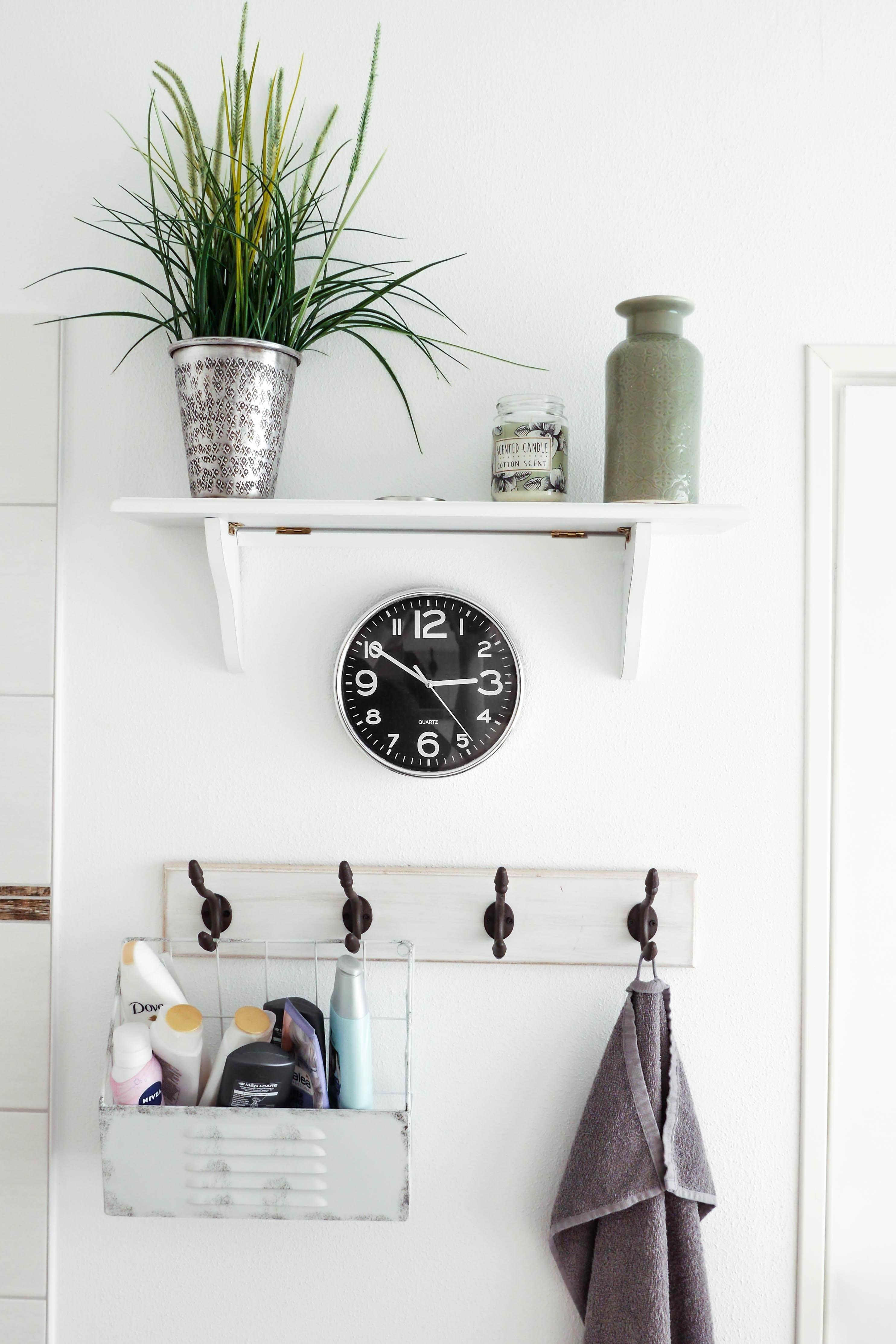 round white analog clock at 3:50