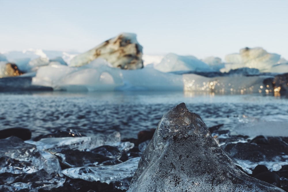 landscape photography of body of water and ice blokcs