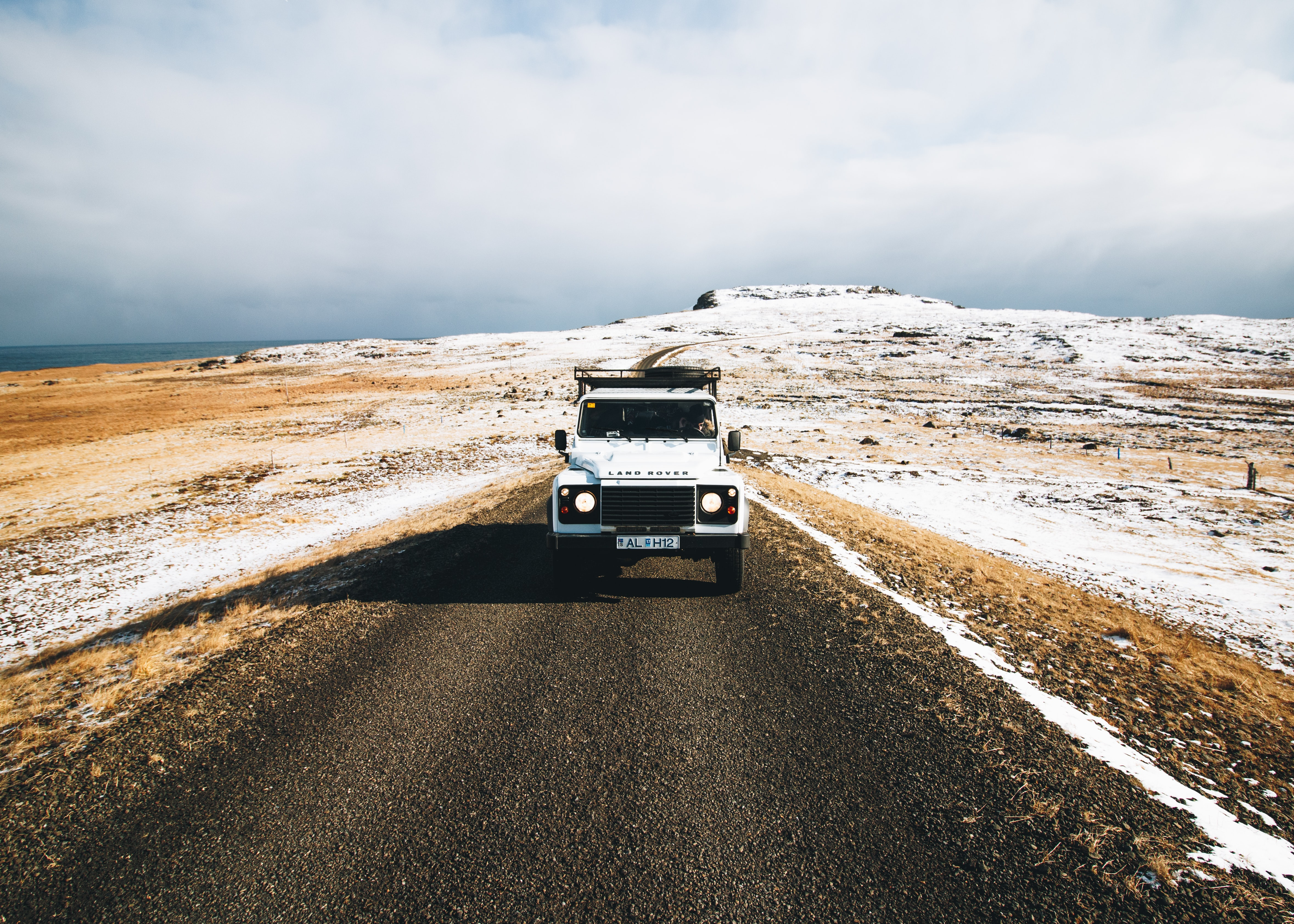 photography of vehicle in road