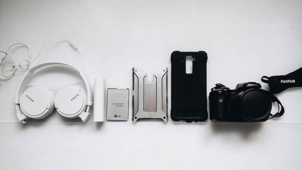 white Sony headphones and black smartphone case