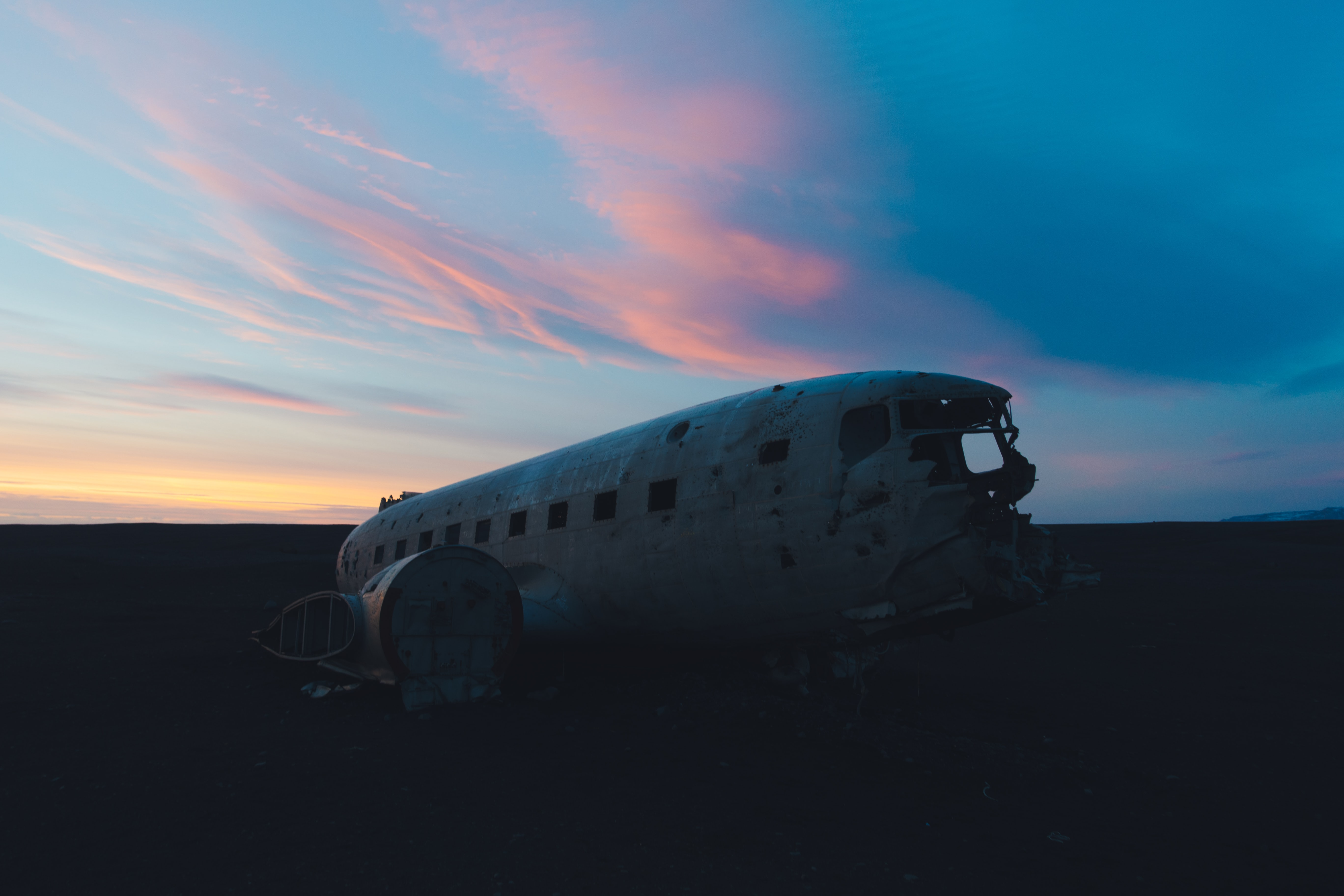 wrecked white airplane on open field