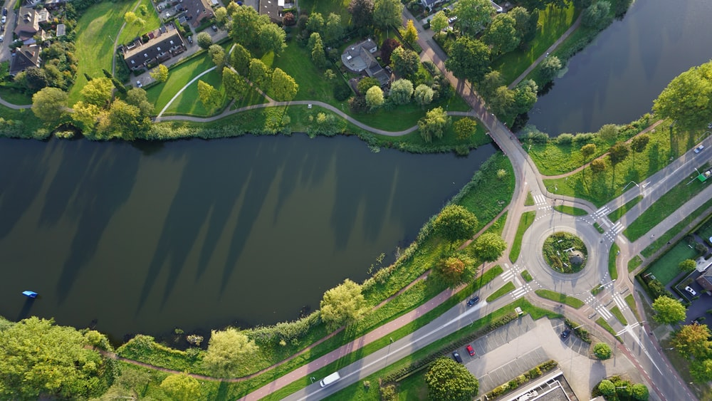aerial photography of river with bridge during daytime