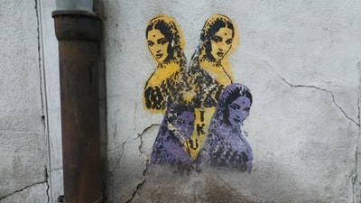 wall with painting of woman