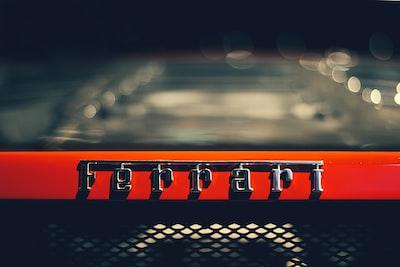 closeup photography of ferrari logo ferrari zoom background