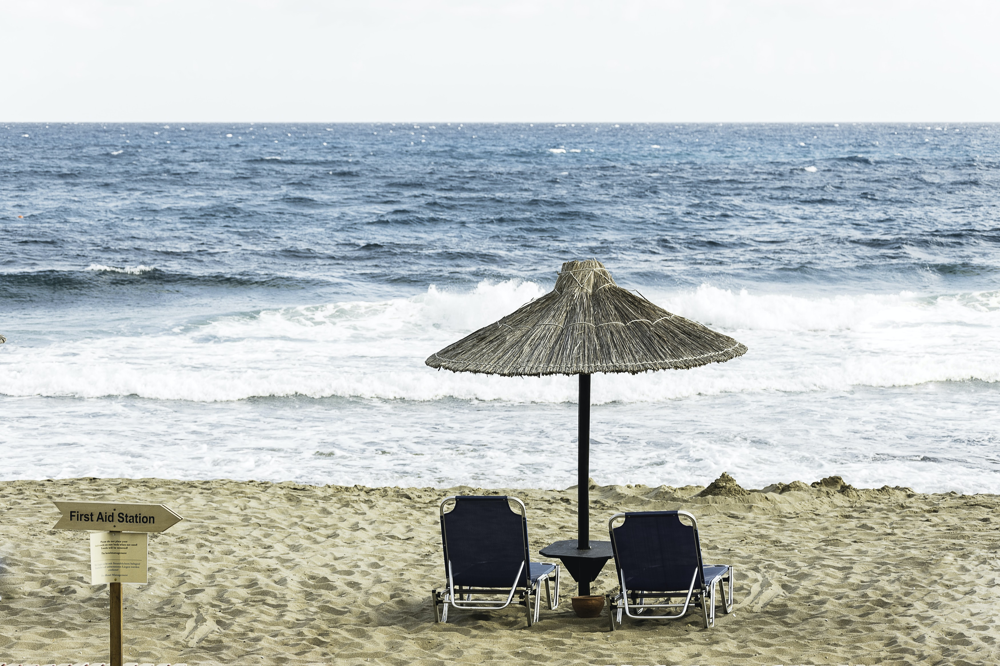 two black beach chair on the seashore