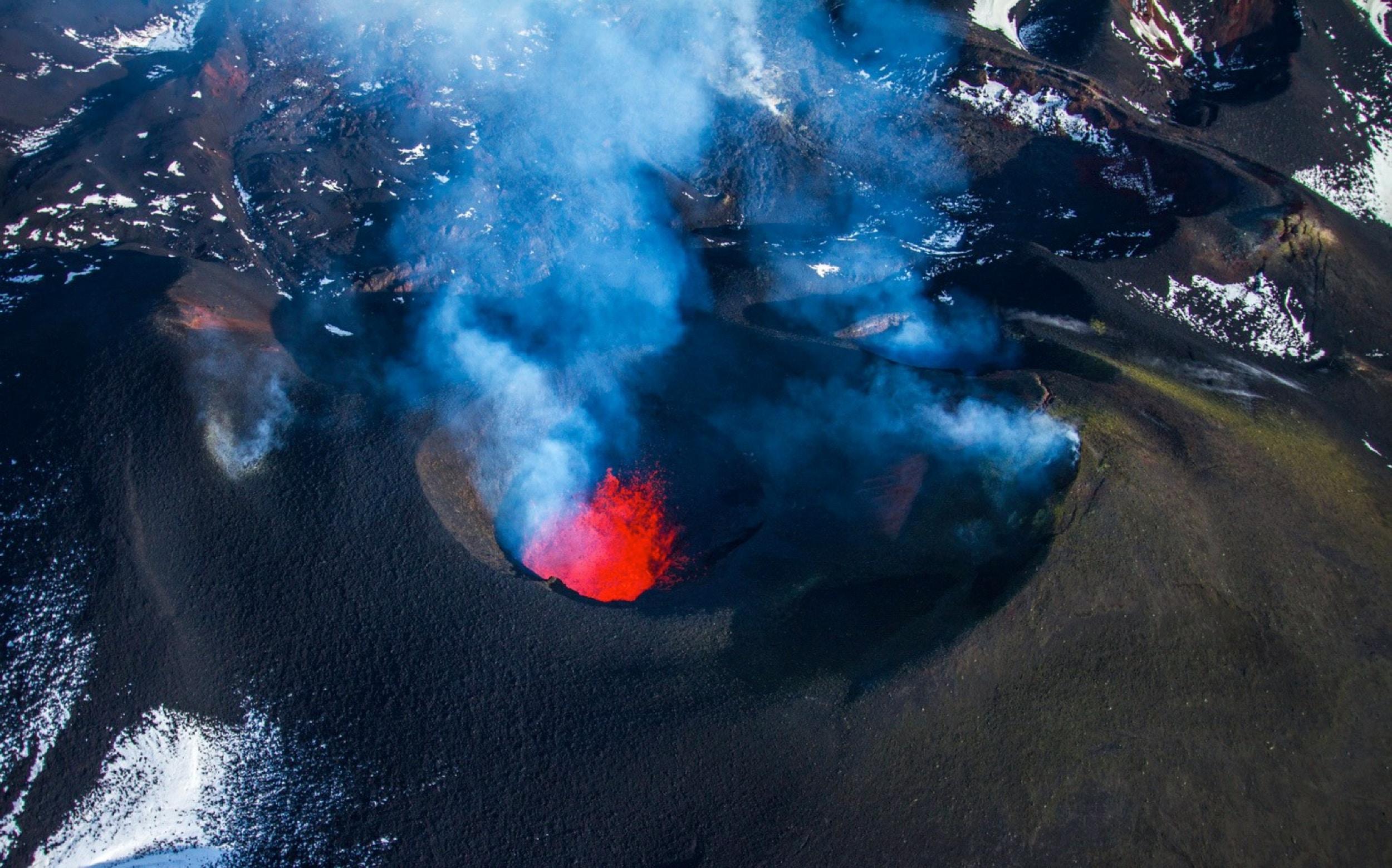 black volcano during daytime
