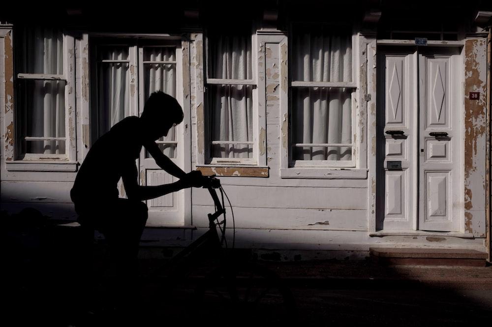silhoutte of man riding bike