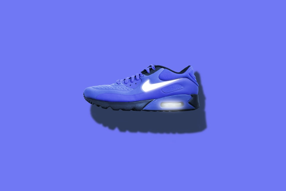 blue, white, and black Nike running shoes