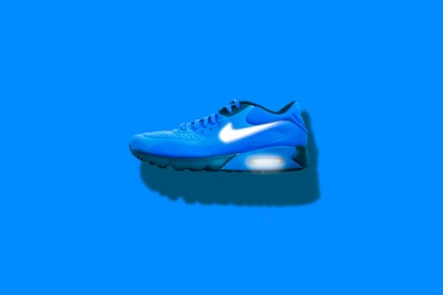 blue, white, and black nike running shoes product teams background