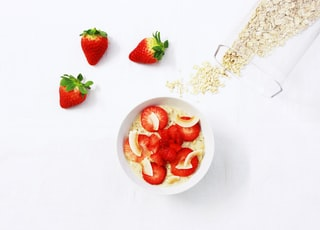 sliced strawberries on white cup