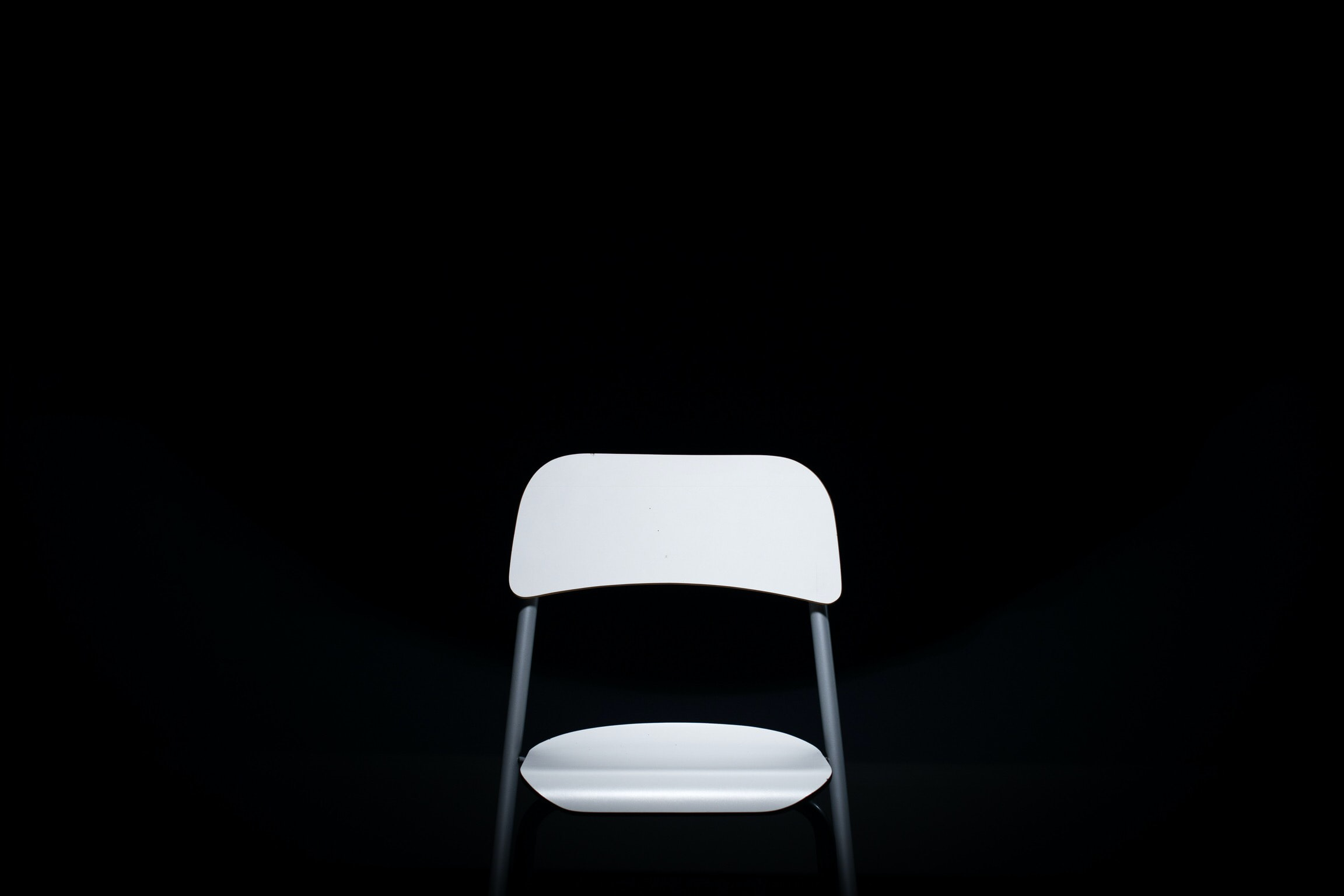 white and gray metal armless chair