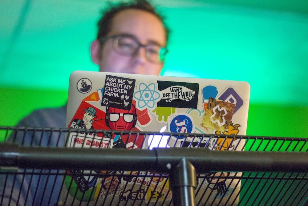 person facing laptop computer